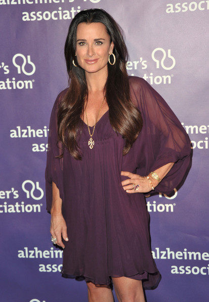 Kyle Richards attended a Beverly Hills fundraiser with straight long locks parted down the center.