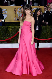 Lea Michele looked jaw-droppingly pretty in this strapless pink gown with a floating ruffle hem.