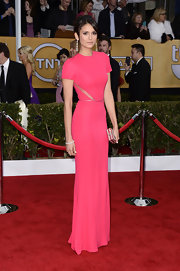 Nina Dobrev looked refined yet breathtaking in this pink gown with delicate sheer insets and a tiny waist belt.