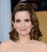 Tina Fey upped the retro factor of buoyant curls at the 2013 SAG Awards  by flipping them up and over to one side.