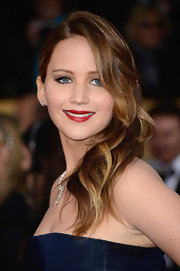 Jennifer Lawrence vamped up her Dior Couture gown at the 2013 SAG Awards with rich red lipstick.