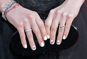 Anne Hathaway accented her nails with hand-drawn butterflies for the 2013 SAG Awards.