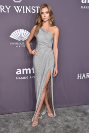 Josephine Skriver looked phenomenal in a high-slit silver one-shoulder gown by Valentin Yudashkin at the amfAR New York Gala.