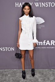 Liya Kebede continued the edgy vibe with a pair of pointy black booties, also by Versace.