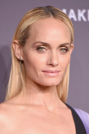 Amber Valletta wore her hair slicked down and straight when she attended the amfAR New York Gala.