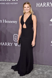 Rachel Hilbert flashed some skin in a deep-V black cutout gown by Michael Kors at the amfAR New York Gala.