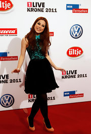 Lena Meyer-Landrut could have easily gone with black pumps but these bold orange heels were so much more refreshing.