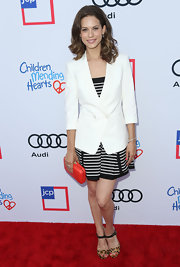 Lyndsy Fonseca arrived at the Children Mending Hearts event wearing an immaculate white double-breasted blazer over a striped dress.
