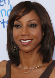 Holly Robinson Peete sported a cool layered bob at the Children Mending Hearts Style Sunday.