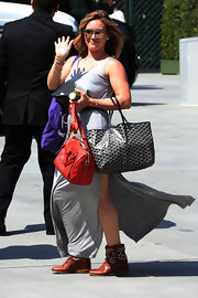 Bag lover Hilary Duff was all geared up with a Goyard tote and an LV cross-body tote at the Children Mending Hearts Style Sunday.