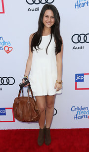 Jade Lovine accessorized with a stylish brown leather tote when she attended the Children Mending Hearts event.