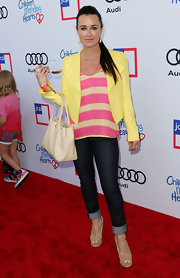 Kyle Richards looked perfectly put together in her rolled-up skinny jeans, yellow jacket, and striped top at the Children Mending Hearts Style Sunday.