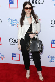 Michelle Trachtenberg topped off her flawless ensemble with a chic black-and-white cross-body tote at the Children Mending Hearts Style Sunday.