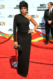 Taraji's black gemstone box clutch brings some sparkle to the stars all black Kaufman Franco dress.