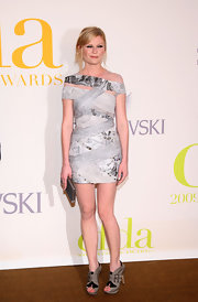 A thin metallic clutch completes Kirsten's grey and silver look.