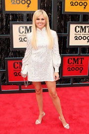 Laura Bell Bundy added dazzle to her sequined mini dress with delicate strappy sandals.