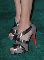 Calista Flockhart added some edge to her evening look with these gray and silver sandals.