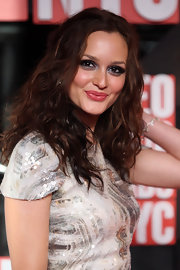 Leighton lets her hair down in these soft curls.