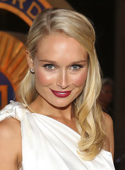 Lee Furlong vamped up her white hot look with deep red lipstick. A brush of peach blush completed her look.