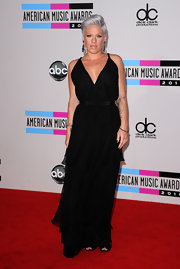 Pink keeps it simple with a long black dress. The chic style is belted and elegantly layered. Check out her new gray 'do!