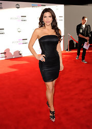 Lauren Sanchez looked fierce in black strappy heels with silver tipped toes. She paired the heels with an ultra fitted black corset dress.