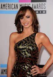 Karina Smirnoff paired her brunette locks with shimmering peach gloss.