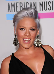 Newly expectant mom to be Pink debuted a funky silver do at the American Music Awards. The singer loves to mix up the color of signature cropped cut.