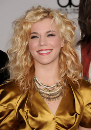 Kimberly Perry showed off a bronze and pearl embellished necklace while attending the American Music Awards.