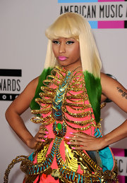 Niki Minaj paired her over-the-top dress with matching pink nail polish. The rapper also opted for bright pink lipstick.