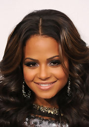 Singer Christina Milian looked lovely at the American Music Awards. The singer paired her fluttering lashes with a soft silver smoky eye.