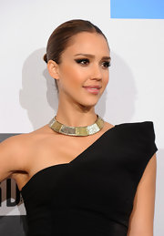 Jessica Alba showed off a sleek bun with a modern center part while attending the 2010 American Music Awards. She completed her sexy look with smoky eyeshadow.