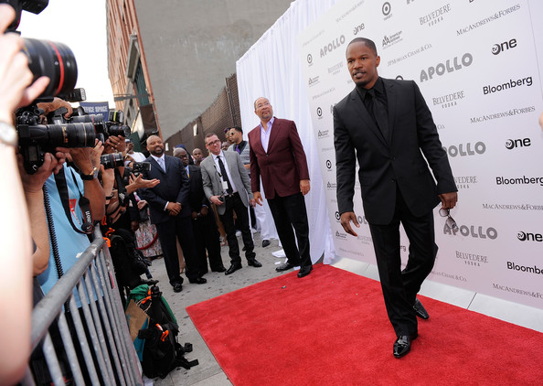 Jamie looked classic and daper in all black as he walked the red carpet outside of the Apollo Theater.