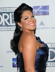 Sara highlighted her strapless dress by pinning her hair up in a half up half down twist.