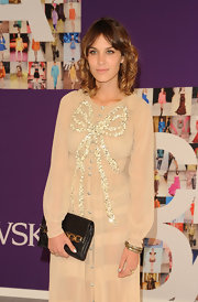 Alexa Chung showed off her shoulder length honey-brown locks on the red carpet.