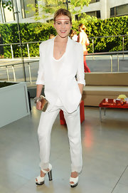 Dree wore bold metal-heeled, platform sandals with her all-white ensemble.
