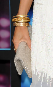 Sheryl Crow paired her sequin white dress with bangle bracelets.