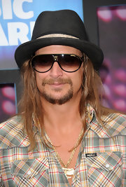 Kid Rock paired his black fedora hat with classic aviator shades.