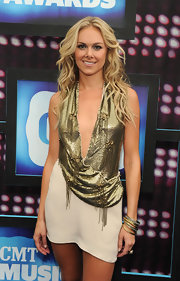 Laura paired her gold sequin dress with a pair of bangle bracelets.