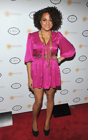 Marsha brightens up the red carpet in this silk fuchsia cocktail dress and gold jewelry.
