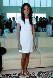 Naomie Harris dressed down her little white dress with flat gold sandals with a . Simple hair and makeup completed her effortlessly chic look.