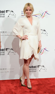 Emma Caulfield paied her winter white frock with metallic bronze pointy toe pumps.