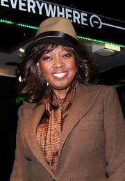Star Jones rocks a two-tone fedora with her classic prep ensemble.