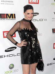 Jessica Sutta matched her nails with her dress as she painted them with black polish for the EMI Grammy party.