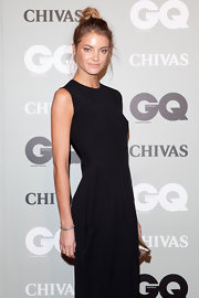 Elyse Taylor paired her sleeveless gown with a high twisted bun while attending the 'GQ' Men of the Year Awards.