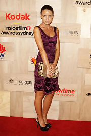 Jodi paired her satin deep purple dress with a fierce leopard print clutch.