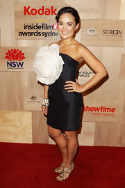 This was no ordinary little black dress! Yumi Stynes boldly sported an avant garde flower with her strapless black cocktail dress.