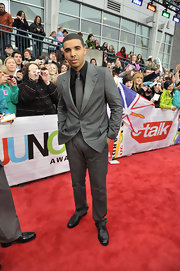 Drake paired his gray tie and black button down shirt with a slate gray suit.