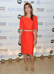 Queen Rania looked sophisticated in an orange belted pencil dress.