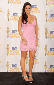"Miss ""J-Woww"" popped up (and almost popped out) on the red carpet in a lace halter dress from her new clothing range."