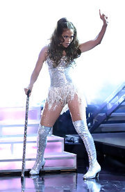 J-Lo made a surprise performance in a glittering showgirl ensemble paired with metallic over the knee boots. Wow!